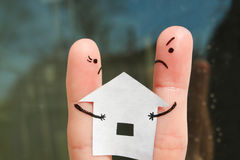 Finger art of family during quarrel. Concept of man and woman cannot divide house after divorce Stock Image