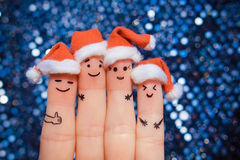 Finger art of friends celebrates Christmas. Stock Photos