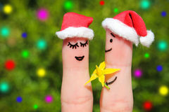 Finger art of a Happy couple in Christmas hats. Royalty Free Stock Photos