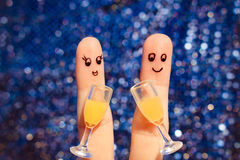 Finger art of a Happy couple. Couple making good cheer. Two glasses of champagne. Toned image royalty free stock images