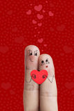 Finger art of a Happy couple. Lovers is embracing and holding red heart. Stock Image. Happy Valentine's Day theme series. Painted fingers smile and love Stock Photos