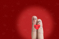Finger art of a Happy couple. Lovers is embracing and holding red heart. Stock Image. Happy Valentine's Day theme series. Painted fingers smile and love Royalty Free Stock Photo