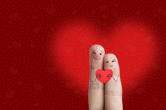 Finger art of a Happy couple. Lovers is embracing and holding red heart. Stock Image. Happy Valentine's Day theme series. Painted fingers smile and love Royalty Free Stock Images