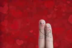 Finger art of a Happy couple. Man is embracing and giving flower. Happy Valentines Day theme series. Painted fingers smile and love. There are path included in stock photography