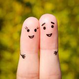 Finger art of a Happy couple. A man and a woman hug on the background of yellow leaves Stock Photography