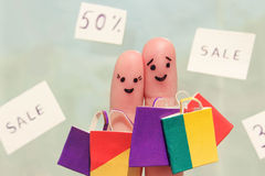 Finger art of a Happy couple with shopping bags Royalty Free Stock Images