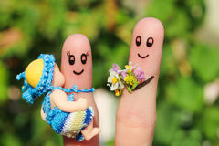Finger art of a Happy family holding a small child. Concept of husband giving flowers to his wife for birth of child Stock Photo
