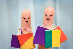 Finger art of a Happy friends with shopping bags Stock Images