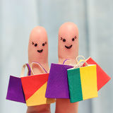 Finger art of a Happy friends with shopping bags Stock Photography
