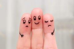 Finger art. Happy man embraces two women Royalty Free Stock Image