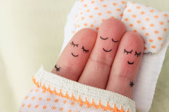 Finger art. Happy man sleeps with two women.  Royalty Free Stock Images