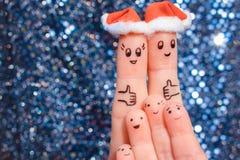 Finger art of large family celebrates Christmas. Stock Images