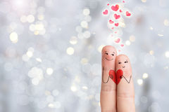 Finger art. Lovers is holding red heart. Bokeh. Stock image Royalty Free Stock Images