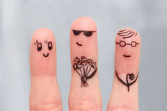 Finger art. Men give flowers flowers to woman. Royalty Free Stock Photo