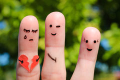Finger art of people. Man flirts with woman. Other girl is holding broken heart. Royalty Free Stock Images