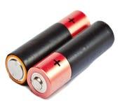 Finger-artige Batterien der AA-Größe auf einem weißen Hintergrund Stockbilder