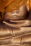 Finger av den buddha statyn Arkivfoton