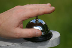 Finger on bell about to ring Stock Images