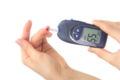 Finger blood measure a glucose blood level test Royalty Free Stock Image