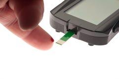 Finger blood test. Diabetes blood sugar test royalty free stock image
