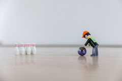 Finger bowling with children`s toys Royalty Free Stock Image