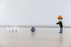 Finger bowling with children`s toys Stock Image