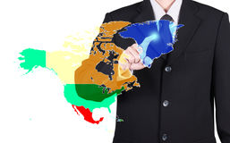 Finger of business man press to north america map Stock Photos