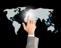 Finger businessman click on world map Royalty Free Stock Image