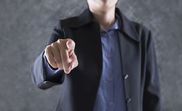 finger of businessman pointing to you for use as hand pushing to Stock Photo