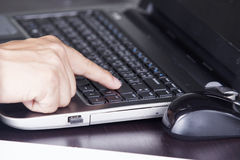Finger of Businessman pressing enter key Stock Photos