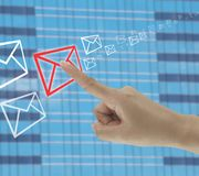 Finger of businessman touches on the envelope icon. Finger of businessman touches on the envelope icon in concept of business communication by email Royalty Free Stock Images