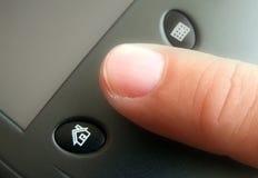 Finger on button Royalty Free Stock Photos