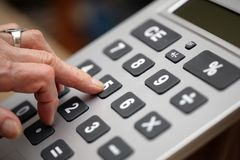 Finger calculator keys Royalty Free Stock Images