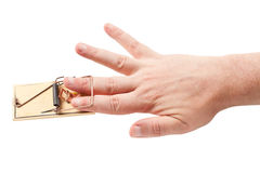 Finger Caught in Mouse Trap Royalty Free Stock Photography