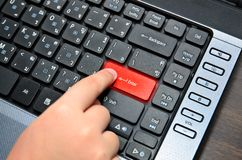 Finger of chind pushing the button of keyboard Stock Photography