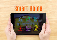 Finger click screen with Smart home application interface with k. Eyboard on wooden table,Internet Business concept Royalty Free Stock Image