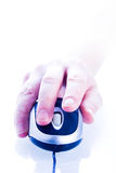 Finger clicking on computer mouse. Hand on computer mouse ready to right click stock photos