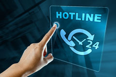 Finger clicking a hotline service Stock Photo