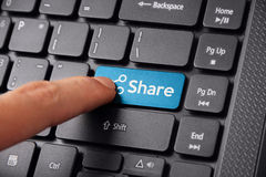 Finger clicking Share on keyboard Royalty Free Stock Photo