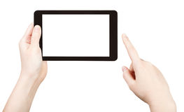 Finger clicking tablet pc with cut out screen Royalty Free Stock Photos