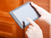 Finger clicking tablet pc in office Stock Photography