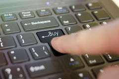 Finger clicks on the keyboard Buy. Closeup Royalty Free Stock Image