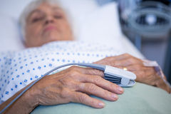 Finger clip on patients hand to monitor pulse. In hospital Stock Images