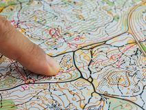 Finger closeup on orienteering map stock photography