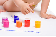 Finger in color paint Stock Photography