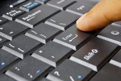Finger on computer keyboard Stock Photos