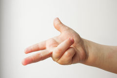 Finger counts two. Child. all is well. Over Royalty Free Stock Photos