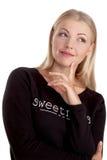 Finger de pensamiento hermoso de la mujer joven o del estudiante en la barbilla Imagen de archivo libre de regalías
