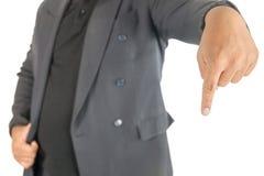 Finger del punto del hombre de negocios abajo en blanco Imagenes de archivo