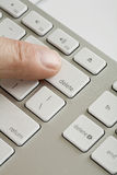 Finger on delete key Stock Image